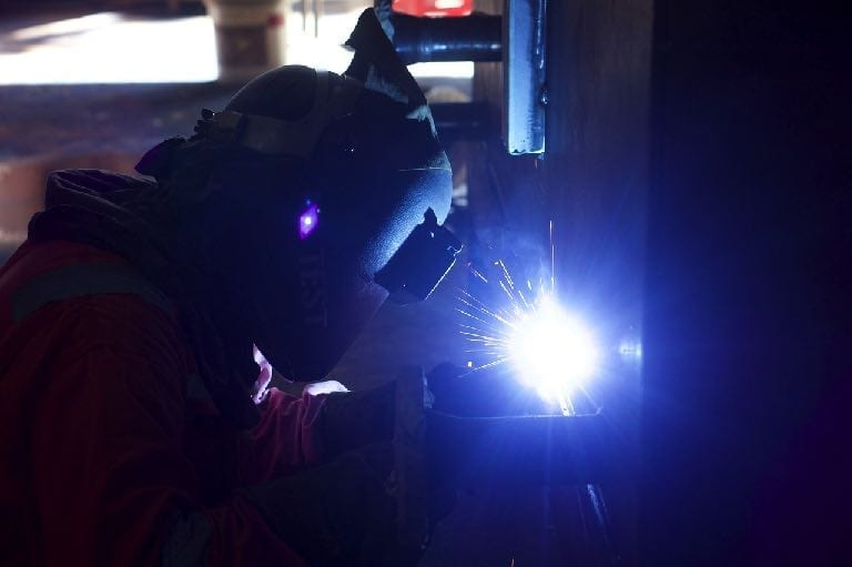 Image of welder wearing safety equipment